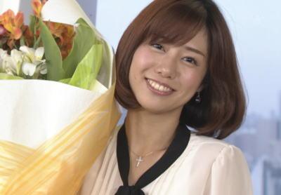 花束を持つ山崎夕貴